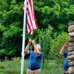 Jud Butterman raising the new flag